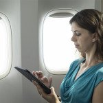 executive-travel-assistant-in-the-air-laptops-and-other-electronic-devices