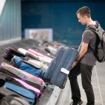 executive-travel-assistant-luggage-identifying-your-suitcase-at-the-airport